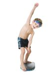 Child with swimming board over white Royalty Free Stock Photos
