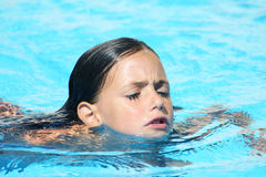 Child swimming breast stroke Royalty Free Stock Images