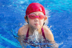 Child Swimming Breaststroke in Swimming Pool Royalty Free Stock Photos