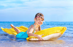 Child swimming on inflatable beach mattress. Royalty Free Stock Images