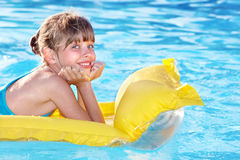 Child swimming on inflatable beach mattress. Royalty Free Stock Image