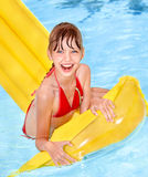 Child swimming on inflatable beach mattress. Royalty Free Stock Photo