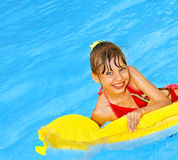 Child swimming on inflatable beach mattress. Stock Photos