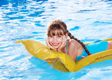 Child swimming on inflatable beach mattress. Royalty Free Stock Photography