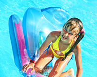 Child swimming on inflatable beach mattress. stock photos