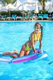Child swimming on inflatable beach mattress Royalty Free Stock Photography