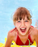 Child swimming on inflatable ring . Royalty Free Stock Image