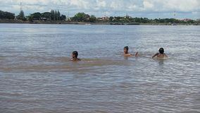 Child, swimming, mekong , cambodia, southeast asia stock footage