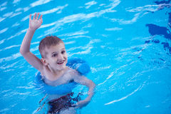 Child on swimming poo Royalty Free Stock Image