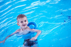 Child on swimming poo Royalty Free Stock Photo