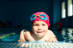 Child in a swimming pool Stock Images