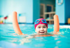 Child in a swimming pool Royalty Free Stock Image