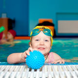 Child in a swimming pool Stock Photo