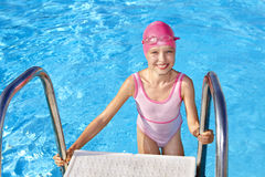 Child swimming in pool. Stock Photos