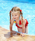 Child swimming in pool. Little girl swimming in pool Royalty Free Stock Photo