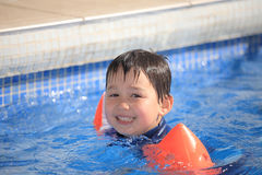 Child in the swimming pool Royalty Free Stock Photos