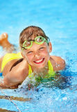 Child in swimming pool. Little girl in swimming pool. Summer outdoor Stock Image