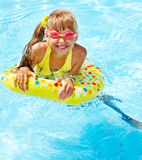 Child in swimming pool. Royalty Free Stock Photo