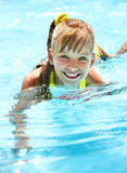 Child in swimming pool. Little girl in swimming pool. Summer outdoor Royalty Free Stock Photo