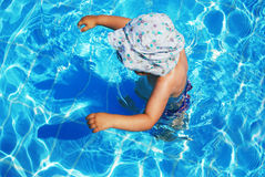 Child in swimming pool. Greece Stock Images