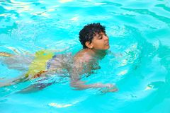 Child swimming at Pool. Countryside of Egypt park with Pool stock photo
