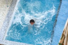 Child swimming at Pool. Countryside of Egypt park with Pool royalty free stock photos