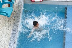 Child swimming at Pool. Countryside of Egypt park with Pool stock image