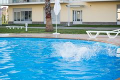 A child is swimming in the pool. At the resort Stock Photography