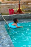 Child swimming at Pool. Countryside of Egypt park with Pool stock photography