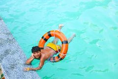 Child swimming at Pool. Countryside of Egypt park with Pool royalty free stock photo