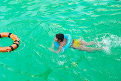 Child at swimming Pool. Child swimming at Pool Countryside of Egypt park with Pool royalty free stock photo