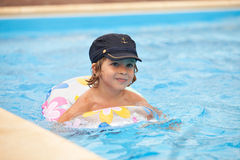 Child swimming in the pool Royalty Free Stock Photos
