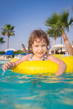 Child in swimming pool. Happy child playing in swimming pool. Summer vacations concept Royalty Free Stock Photo