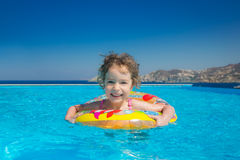 Child in swimming pool Stock Image