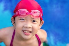 Child in Swimming Pool. Happy smiling child in swimming pool outdoor Royalty Free Stock Image