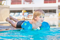 Child in the swimming-pool Stock Images