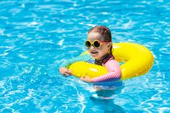 Child in swimming pool. Kids swim. Water play royalty free stock images
