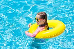 Child in swimming pool. Kids swim. Water play stock images