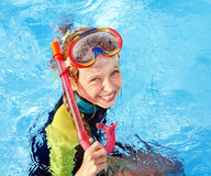 Child in swimming pool learning snorkeling. Sport royalty free stock images