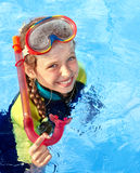 Child in swimming pool learning snorkeling. Stock Photo