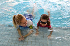 Child swimming pool lesson Royalty Free Stock Photos