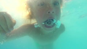 Child swimming in a pool stock video