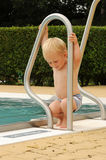 Child by swimming pool Royalty Free Stock Images