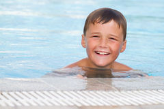 Child in swimming pool - Pool Boy Stock Photos