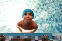 Child in swimming pool. Portrait of child in the swimming pool stock image