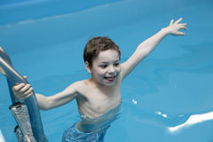 Child in swimming pool. Portrait of a child in swimming pool Royalty Free Stock Image