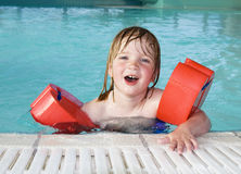 Child swimming pool portrait. Child in swimming-pool with wings. toddler in water in leisure center royalty free stock photo