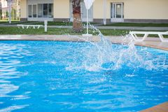 A child is swimming in the pool. At the resort Royalty Free Stock Photo