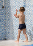 Child at swimming pool shower Stock Photos
