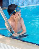 Child at swimming pool steps Stock Photos